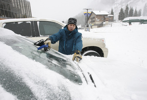 Scott Sommerdorf  |  The Salt Lake Tribune               Scott Mathers, manager of the ski school at Alta, cleans off his windshield before leaving the resort Friday afternoon, Nov. 8, 2012.