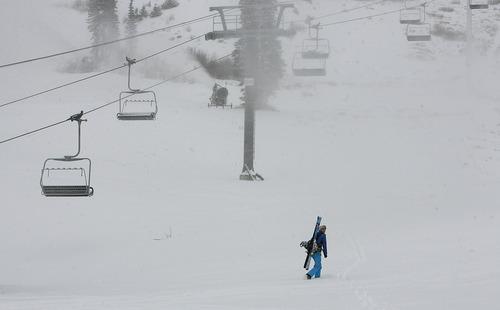Scott Sommerdorf  |  The Salt Lake Tribune               Megan Monahan, visiting from Missoula, hikes up near the closed Collins Lift at Wildcat Base at Alta Ski Area, Friday, November 8, 2012