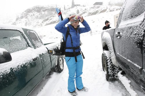 Scott Sommerdorf  |  The Salt Lake Tribune               Megan Monahan, visiting from Missoula, gets her gear together prior to hiking up near the closed Collins Lift at Wildcat Base at Alta Ski Area, Friday, November 8, 2012