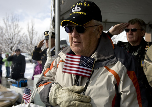 Kim Raff  |  The Salt Lake Tribune Army veteran Fred Montoya stands for the national anthem during the flag ceremony at Taylorsville's Veterans Day Parade Sunday.