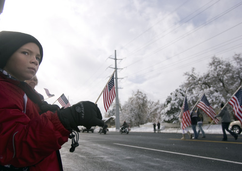 "Kim Raff  |  The Salt Lake Tribune Spectators line 2700 West in Taylorsville during the Veterans Day Parade Sunday. The theme for this year's parade is ""Welcome Home, Korean and Vietnam Veterans."""