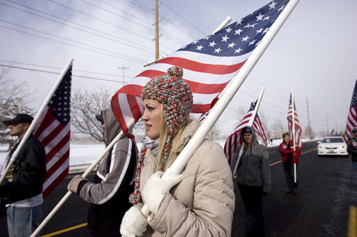 Kim Raff  |  The Salt Lake Tribune Brittany Ladenburg walks with the Patriot Guard Riders during the Veterans Day Parade Sunday.