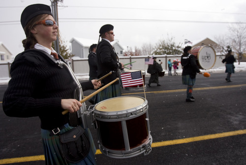 "Kim Raff  |  The Salt Lake Tribune Vanessa Legrande Larsen marches with the Utah Pipe Band during  the Veterans Day Parade Sunday. The theme for this year's parade is ""Welcome Home, Korean and Vietnam Veterans."""