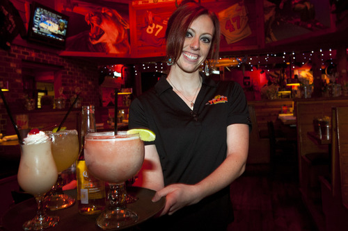 "Chris Detrick  |  The Salt Lake Tribune Under the bill, chains could hold a single ""master"" license for full service, allowing all types of alcohol. For instance, Texas Roadhouse, where manager Daphnee Barnes served drinks Wednesday, would have a license for all of its Utah locations, rather than the nine separate liquor permits that it holds."
