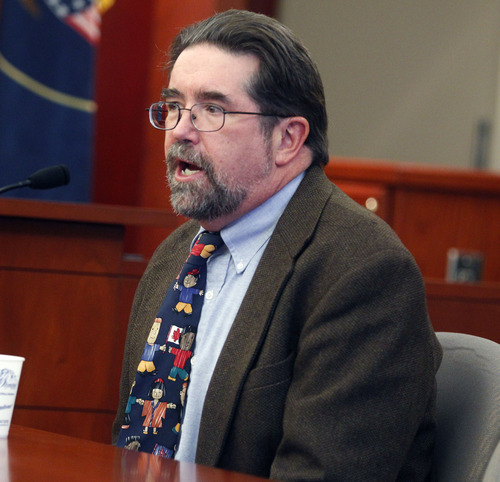 Al Hartmann  |  The Salt Lake Tribune Dr. Todd Grey, Utah Medical Examiner,  testifies in Esar Met's preliminary hearing in Judge William Barrett's 3rd District Court in Salt Lake City Thursday November 8 . Esar Met is accused of killing 7-year-old Hser Ner Moo in 2008.