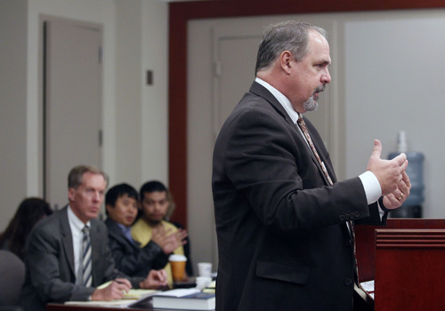 Al Hartmann  |  The Salt Lake Tribune Prosecuting attorney Robert Parrish questions a witness in Esar Met's preliminary  hearing in Judge William Barrett's 3rd District Court in Salt Lake City on Tuesday, Nov. 13. Esar Met is accused of killing 7-year-old Hser Ner Moo in 2008.