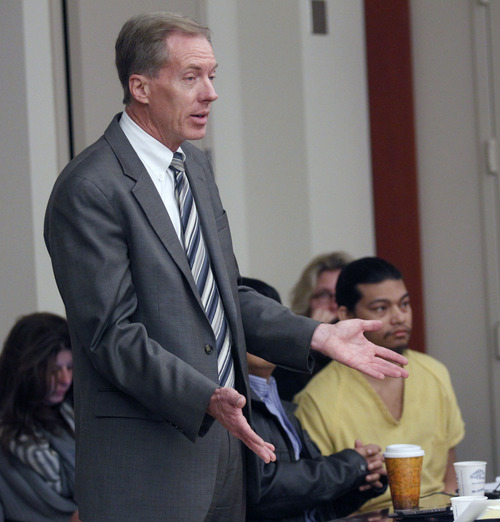 Al Hartmann  |  The Salt Lake Tribune Defense lawyer Michael Peterson, who represents Esar Met, accused of killing 7-year-old Hser Ner Moo in 2008, questions a witness in Judge William Barrett's district courtroom in Salt Lake City on Tuesday, Nov. 13.