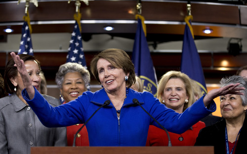House Minority Leader Nancy Pelosi of Calif., accompanied by women House Democrats, gestures during a news conference on Capitol Hill in Washington, Wednesday, Nov. 14, 2012, where she announced that she wants to remain as the top Democrat in the House of Representatives. From left are, Rep. Nydia Velazquez, D-N.Y., Rep.-elect Joyce Beatty, D-Ohio, Pelosi, Rep. Carolyn Maloney, D-N.Y., and Rep.-elect Gloria Negrete McLeod, D-Calif. (AP Photo/J. Scott Applewhite)