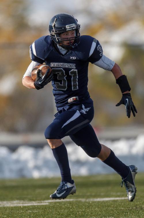 Trent Nelson  |  The Salt Lake Tribune Duchesne's McKade Nielsen runs for a touchdown. Duchesne vs. Rich High School, 1A state football championship, Saturday November 10, 2012 in Pleasant Grove.