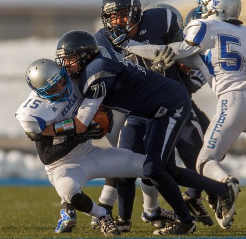 Trent Nelson  |  The Salt Lake Tribune Duchesne's Tristton Banham sacks Rich's Austin Groll. Duchesne vs. Rich High School, 1A state football championship, Saturday November 10, 2012 in Pleasant Grove.