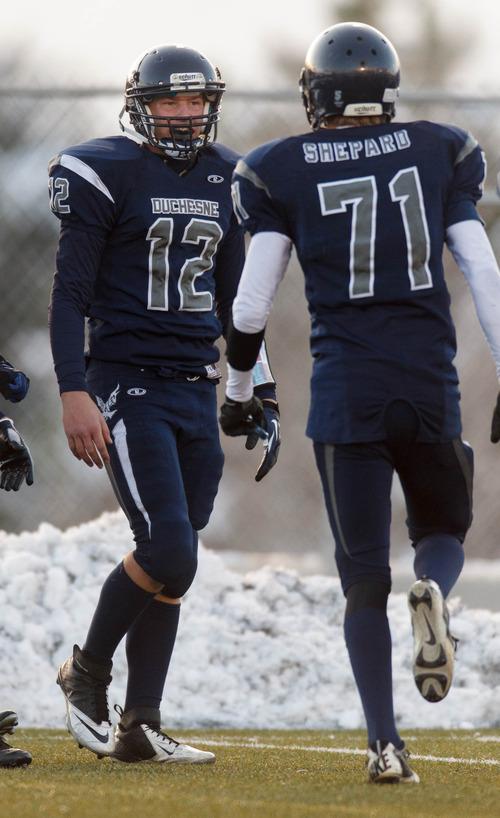 Trent Nelson  |  The Salt Lake Tribune Duchesne's Trent Roberts (12) and Wade Shepard celebrate a Roberts' touchdown. Duchesne vs. Rich High School, 1A state football championship, Saturday November 10, 2012 in Pleasant Grove.