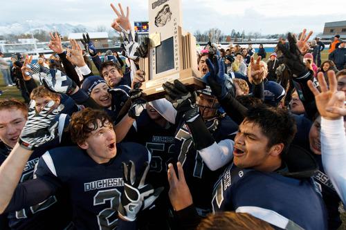 Trent Nelson  |  The Salt Lake Tribune Duchesne players celebrate their championship win. Duchesne vs. Rich High School, 1A state football championship, Saturday November 10, 2012 in Pleasant Grove.