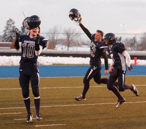 Trent Nelson  |  The Salt Lake Tribune Duchesne's Matt Muir (10) and Kaleb Litster (52) celebrate their championship win. Duchesne vs. Rich High School, 1A state football championship, Saturday November 10, 2012 in Pleasant Grove.