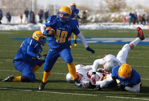 Trent Nelson  |  The Salt Lake Tribune San Juan's Justin Nielson runs the ball. Manti vs. San Juan High School, 2A state football championship, Saturday November 10, 2012 in Pleasant Grove.