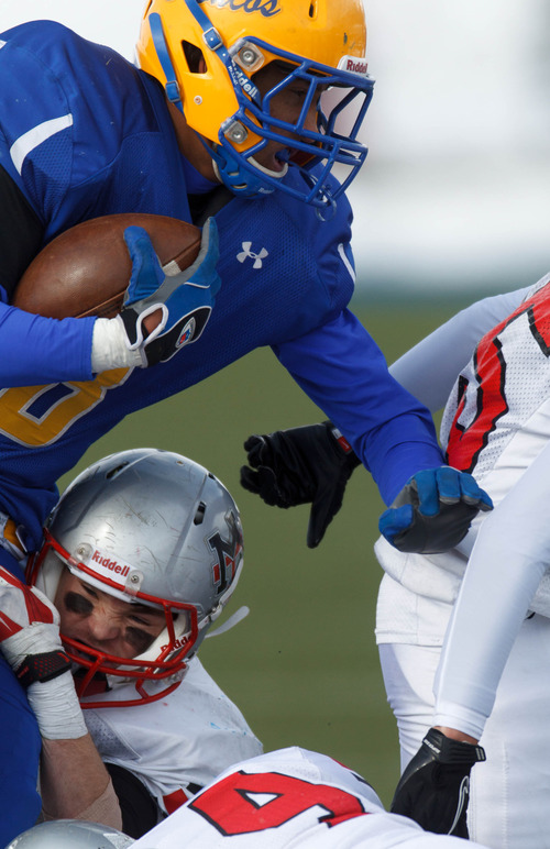 Trent Nelson  |  The Salt Lake Tribune San Juan's Ammon Mitchell runs the ball. Manti vs. San Juan High School, 2A state football championship, Saturday November 10, 2012 in Pleasant Grove.
