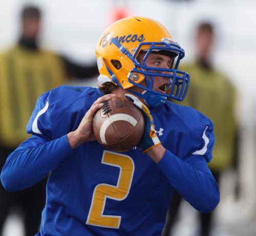 Trent Nelson  |  The Salt Lake Tribune San Juan quarterback Barkley Christensen looks to pass. Manti vs. San Juan High School, 2A state football championship, Saturday November 10, 2012 in Pleasant Grove.