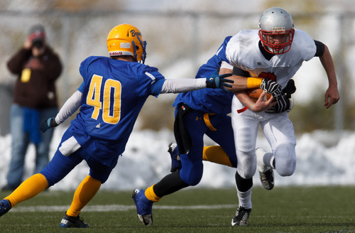 Trent Nelson  |  The Salt Lake Tribune Manti's Zane Stevens is stopped by San Juan's Justin Nielson (40) and Bobby Bowring. Manti vs. San Juan High School, 2A state football championship, Saturday November 10, 2012 in Pleasant Grove.