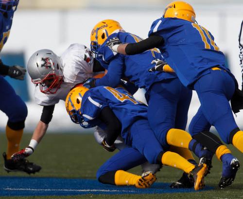 Trent Nelson  |  The Salt Lake Tribune San Juan defenders bring down Manti's Austin Jackson. Manti vs. San Juan High School, 2A state football championship, Saturday November 10, 2012 in Pleasant Grove.