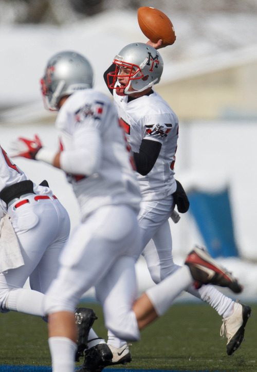 Trent Nelson  |  The Salt Lake Tribune Manti quarterback Connor Aste passes the ball. Manti vs. San Juan High School, 2A state football championship, Saturday November 10, 2012 in Pleasant Grove.