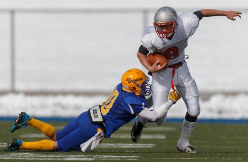 Trent Nelson  |  The Salt Lake Tribune Manti's Zane Stevens breaks free from San Juan's Bobby Bowring. Manti vs. San Juan High School, 2A state football championship, Saturday November 10, 2012 in Pleasant Grove.