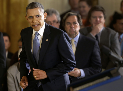 President Barack Obama steps up to the podium before a news conference in the East Room of the White House in Washington Wednesday, Nov. 14, 2012. (AP Photo/Charles Dharapak)