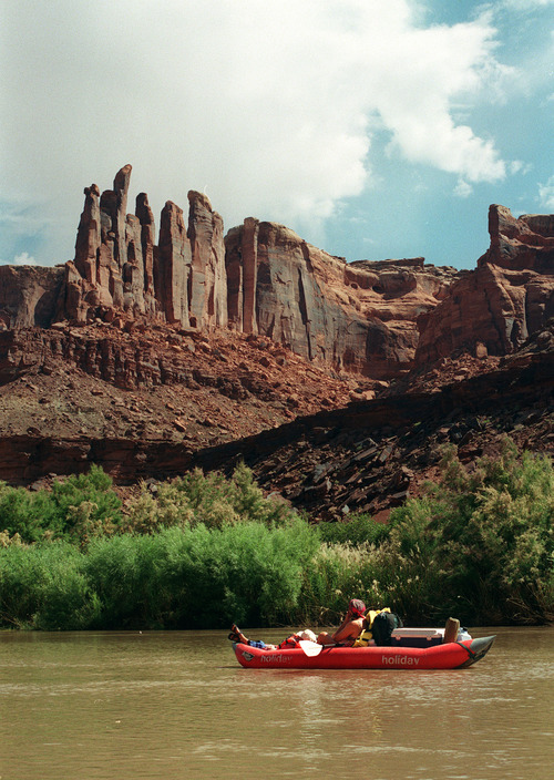 Al Hartmann  |  The Salt Lake Tribune Camper floats on on the Green River beneath the cliffs in Labyrinth Canyon.