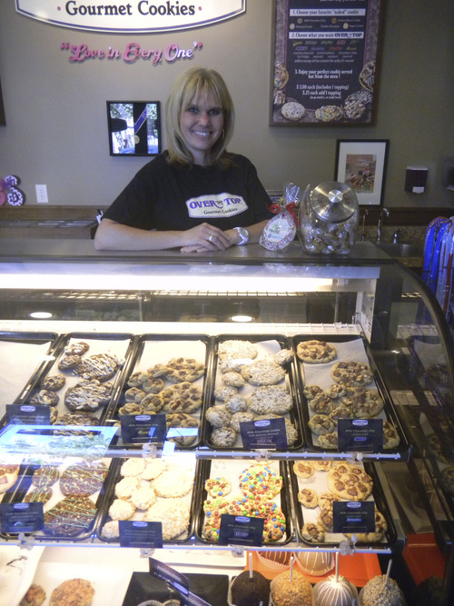 Tom Wharton  |  The Salt Lake Tribune Rachel Smith, owner of Over the Top Gourmet Cookies in South Jordan, specializes in cookies with candy bars on the top.