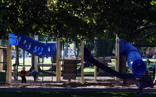 Steve Griffin   The Salt Lake Tribune   Children and parents enjoy the playground equipment at Bountiful City Park, in Bountiful, Utah Monday October 8, 2012.
