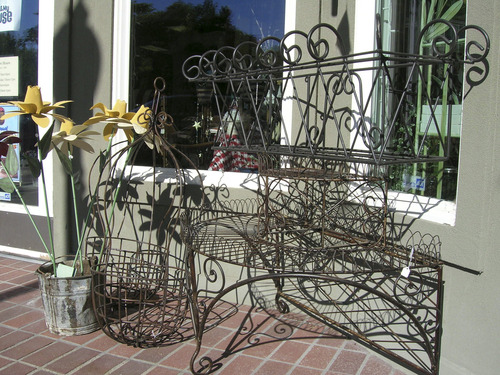 Photo #7 – BountifulÂ's Main Street businesses offer a variety of services to customers. Here, metal artwork casts late afternoon shadows in front of Me and My House. Photo taken 18 July 2005 by Janine S. Creager.