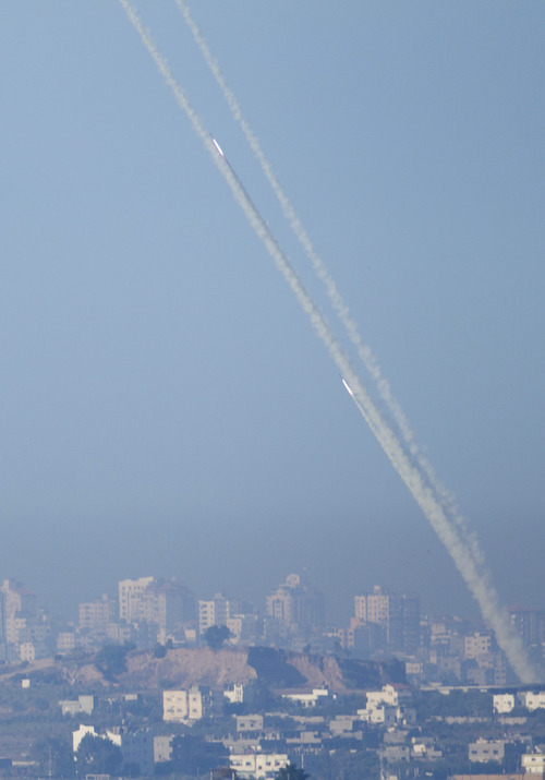 Rockets lunched by Palestinian militants towards Israel make their way from the northern Gaza Strip, seen from the Israel Gaza Border, southern Israel, Thursday, Nov. 15, 2012.  (AP Photo/Ariel Schalit)