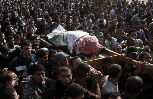 Palestinian mourners carry the body of Hamas' top military commander Ahmed Jabari, killed in an Israeli strike on Wednesday, during his funeral in Gaza City, Thursday, Nov. 15, 2012. (AP Photo/Hatem Moussa)