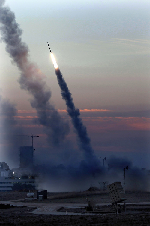 "Iron Dome defense system fires to intercept incoming missiles from Gaza in the port town of Ashdod, Thursday, Nov. 15, 2012. Israel's prime minister Benjamin Netanyahu said Thursday  that the army is prepared for a ""significant widening"" of its operation in the Gaza Strip. (AP Photo /Tsafrir Abayov)"