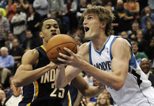 Minnesota Timberwolves' Andrei Kirilenko of Russia, right, and Indiana Pacers' Gerald Green are shown in the first half of an NBA basketball game against the Indiana Pacers Friday, Nov. 9, 2012, in Minneapolis. (AP Photo/Jim Mone)
