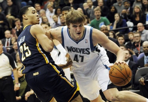 Minnesota Timberwolves' Andrei Kirilenko, right, of Russia, pushes his way past Indiana Pacers' Gerald Green during the second half of an NBA basketball game, Friday, Nov. 9, 2012, in Minneapolis. The Timberwolves won 96-94. (AP Photo/Jim Mone)