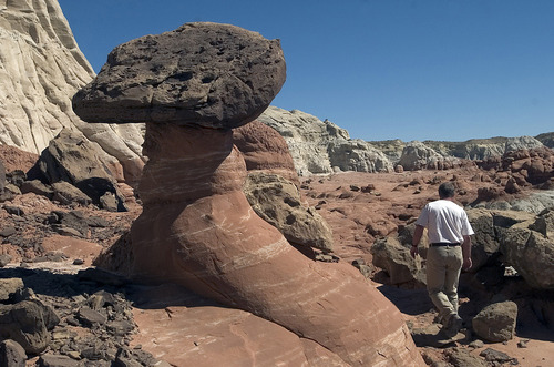"""BLM Geologist Doug Powell makes his way through a rock garden of """"Hoodoo's in the Escalante Grandstaircase National Monument east of Kanab.   Hartmann/photo   10/3/05    For online gallery only"""