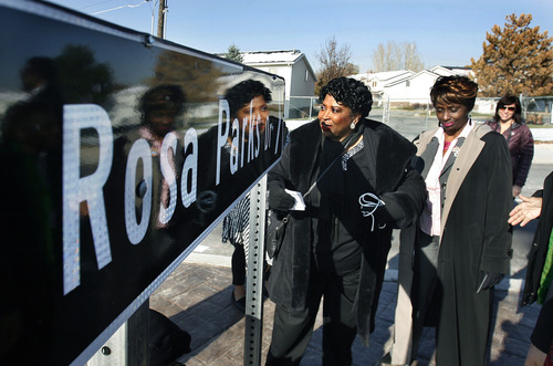 Scott Sommerdorf  |  The Salt Lake Tribune               Jeanetta Williams, NAACP Salt Lake Branch president, left, and Judge Shauna Graves-Robertson admire the Rosa Parks Drive sign they helped to unveil at the southeast corner of the roundabout near the Utah Cultural Celebration Center in West Valley City, Thursday.