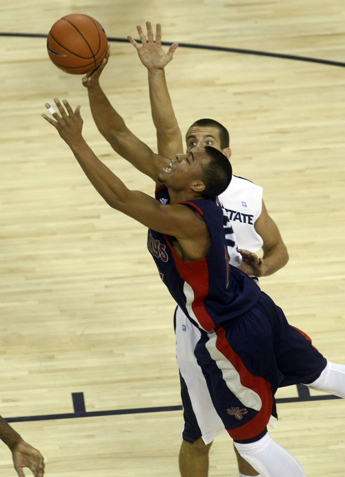 Chris Detrick  |  The Salt Lake Tribune St. Mary's Gaels guard Stephen Holt (14) shoots past Utah State Aggies guard/forward Spencer Butterfield (21) during the second half of the game at Dee Glen Smith Spectrum Thursday November 15, 2012. St. Mary's won the game 67-58.