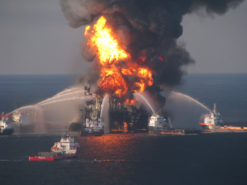 FILE - In this April 21, 2010 file image provided by the U.S. Coast Guard, fire boat response crews battle the blazing remnants of the off shore oil rig Deepwater Horizon. (AP Photo/US Coast Guard, File)