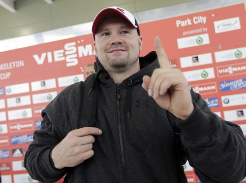 USA's pilot Steven Holcomb celebrates after competing in the two-man bobsled World Cup competition Friday, Nov. 16, 2012, in Park City, Utah.   (AP Photo/Rick Bowmer)