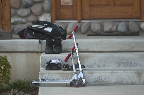 Chris Detrick  |  The Salt Lake Tribune Shoes, scooters and a backpack remain outside a house near 2200 S. Linda Way (1000 West) in Perry Thursday, November 15, 2012. Five boys were burned here Thursday when a can of gasoline exploded as they were apparently lighting it on fire. All of the boys -- ages 7 to 10 -- are expected to survive, said Perry Mayor Jerry Nelson.