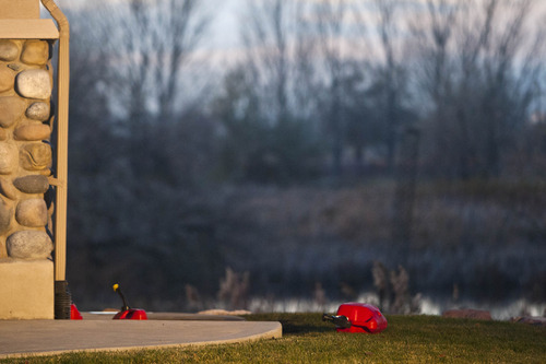 Chris Detrick  |  The Salt Lake Tribune Gas containers are scattered outside a house near 2200 S. Linda Way (1000 West) in Perry Thursday. Five boys were burned Thursday when a can of gasoline exploded as they were apparently lighting it on fire. All of the boys -- ages 7 to 10 -- are expected to survive, said Perry Mayor Jerry Nelson.