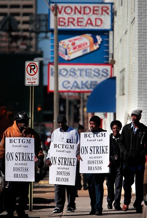 Members of the bakery, confectionery, tobacco, and grain millers union (BCTGM Local 149) gather to strike outside the Hostess bakery on Monroe Monday Nov. 12, 2012, in Memphis, Tenn. The union, which has been on strike since Friday, is trying to prevent new wage and benefit cuts which the company is making nation wide. (AP Photo/The Commercial Appeal, Jim Weber)