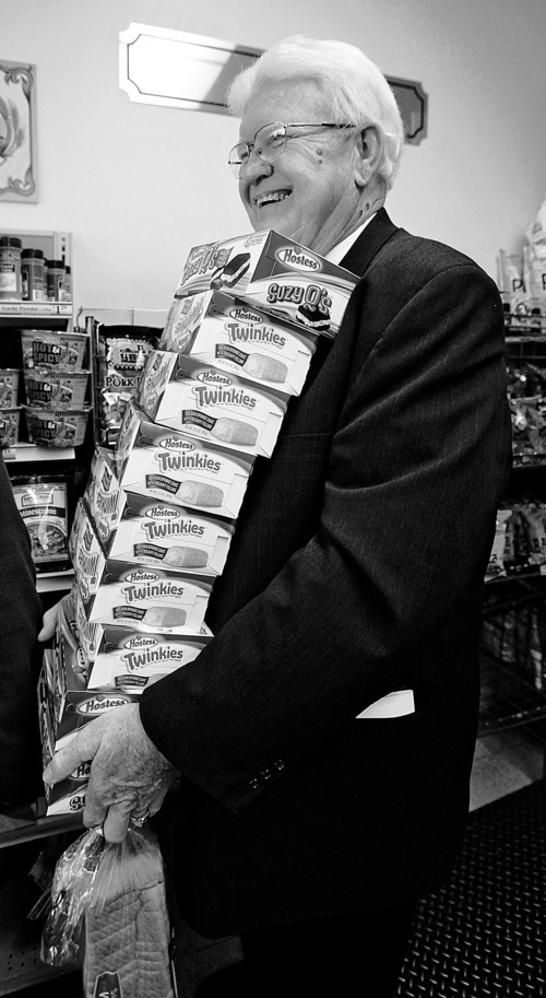 Curtis Smout stands in line with a stack of Twinkies at the Hostess Thrift Shop in Ogden, Utah on Friday, Nov. 16, 2012. Hostess Brands Inc., the maker of the spongy snack with a mysterious cream filling, said Friday it would shutter after years of struggling with management turmoil, rising labor costs and the ever-changing tastes of Americans even as its pantry of sugary cakes seemed suspended in time. (AP Photo/Standard-Examiner, Kera Williams) TV OUT; MANDATORY CREDIT