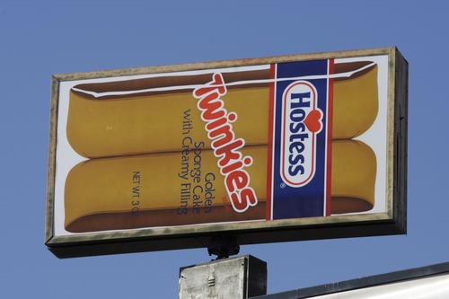 A Hostess Twinkies sign is shown at the Utah Hostess plant in Ogden, Utah, Thursday, Nov. 15, 2012. Hostess Brands Inc. is warning striking employees that it will move to liquidate the company if plant operations don't return to normal levels by Thursday evening. The maker of Twinkies, Ding Dongs and Wonder Bread said Thursday it will file a motion in U.S. Bankruptcy Court to shutter operations if enough workers don't return by 5 p.m. EST. That would result in the loss of about 18,000 jobs, including hundreds in Ogden. (AP Photo/Rick Bowmer)