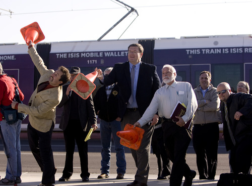 "Kim Raff  |  The Salt Lake Tribune Business owners on North Temple come together Thursday to celebrate completion of the major construction of the new TRAX line to the airport with a ""cone toss"" near the 1940 West North Temple station in Salt Lake City."