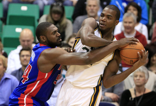 Utah Jazz forward Paul Millsap, right, is defended by Detroit Pistons forward Jason Maxiell during the first half of an NBA basketball game Monday March 12, 2012, in Salt Lake City.  (AP Photo/Jim Urquhart)