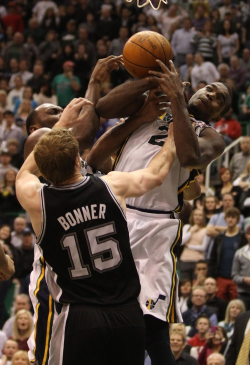 Rick Egan    The Salt Lake Tribune   San Antonio Spurs power forward Matt Bonner (15) keeps the ball out of the hands of Paul Millsap (24) in NBA action in Salt Lake City, Monday, February 20, 2012.