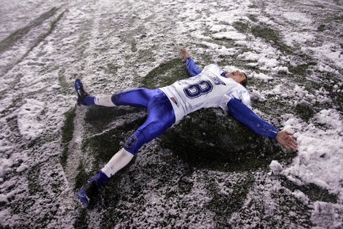 Kim Raff  |  The Salt Lake Tribune Dixie player Chance Aplanalp makes a snow angle on the field after Dixie defeated Juan Diego 14-13 during the 3A State Semifinal at Rice-Eccles Stadium in Salt Lake City, Utah on November 9, 2012.