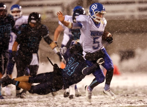 Kim Raff  |  The Salt Lake Tribune Dixie quaterback Blake Barney runs the ball as Juan Diego player David Alexander tries to make the tackle during the 3A State Semifinal at Rice-Eccles Stadium in Salt Lake City, Utah on November 9, 2012. Dixie went on to win the game 14-13.