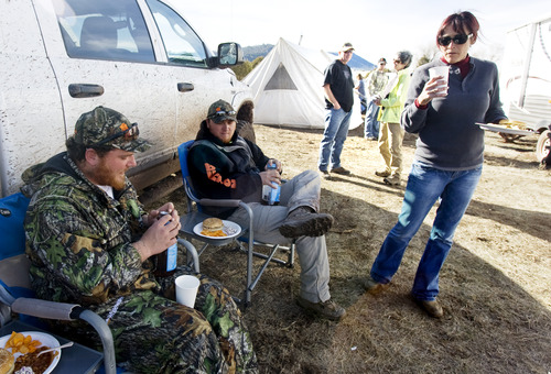 Kim Raff | The Salt Lake Tribune (middle) Ace and (left) Joey Redhair talk with (right) Dana Gurr during dinner at hunting camp in the Diamond Mountain area outside of Vernal on Oct. 30, 2012. Redhair is a wounded Army veteran who was selected for the first-ever Sgt. Daniel D. Gurr Foundation's deer and elk hunt. David Gurr's son, Daniel, died in Afghanistan in August 2011, and he and his wife, Dana, have created a foundation that takes wounded veterans hunting.